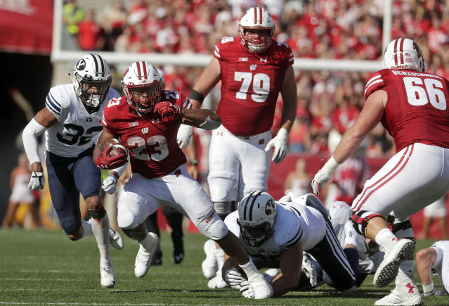 FILE - In this Sept. 15, 2018, file photo, Wisconsin's Jonathan Taylor runs during the first half of an NCAA college football game against BYU Saturday,, in Madison, Wis. The nations leading rusher, Wisconsins Jonathan Taylor, is headed back east when the Badgers face No. 21 Penn State on Saturday. (AP Photo/Morry Gash, File)