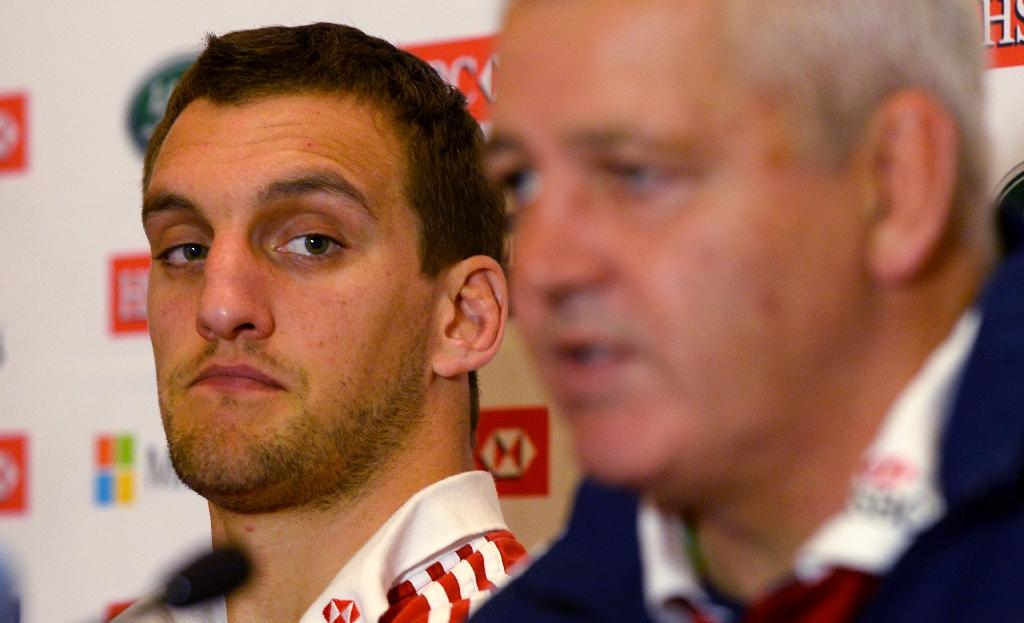 British and Irish Lions captain Sam Warburton (L) listens to coach Warren Gatland speaking at a press conference in Melbourne (AFP Photo/WILLIAM WEST)