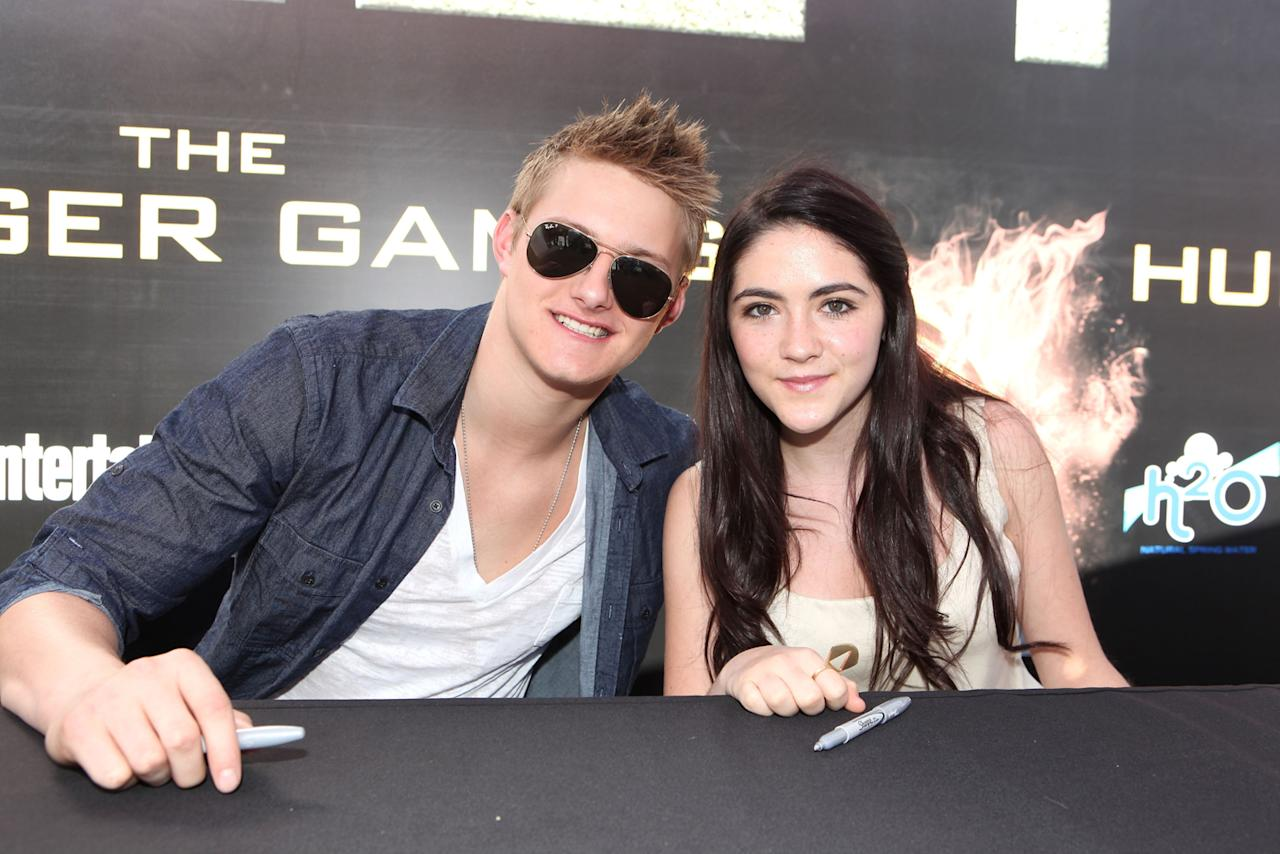 "Alexander Ludwig and Isabelle Fuhrman at ""The Hunger Games"" World Premiere: ""The Hob"" Fan Event held at Nokia  Theatre LA Live on March 11, 2012 in Los Angeles, California."