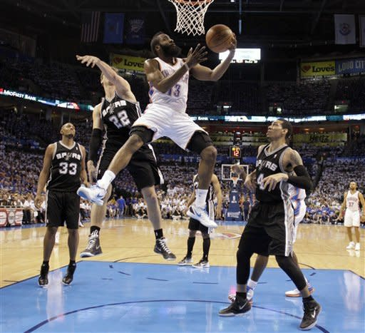 Oklahoma City Thunder guard James Harden (13) shoots as San Antonio Spurs' Tiago Splitter (22), of Brazil, and Danny Green (4) defend during the first half of Game 4 in the NBA basketball playoffs Western Conference finals, Saturday, June 2, 2012, in Oklahoma City. (AP Photo/Eric Gay)