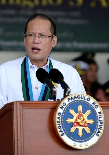 """Philippine President Benigno Aquino gives a speech during the 77th anniversary celebration of the Armed Forces of the Philippines at the Camp Aguinaldo in Manila, on December 21, 2012. Aquino has approved a landmark law that criminalises """"enforced disappearances"""", a presidential spokeswoman said on Saturday, in a move hailed by human rights groups"""