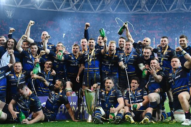 Leinster's players celebrate with the trophy after the 2018 European Champions Cup final on May 12, 2018 (AFP Photo/GABRIEL BOUYS )