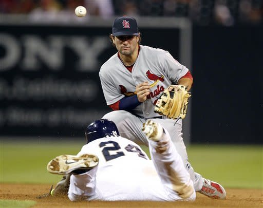 St. Louis Cardinals shortstop Pete Kozma, right, has the ball bounce off his glove on a throw from the outfield as San Diego Padres' Cameron Maybin (24) slides in for a double during the eighth inning of their baseball game in San Diego, Calif., Monday, Sept. 10, 2012. (AP Photo/Alex Gallardo)