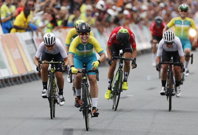 Cycling - Gold Coast 2018 Commonwealth Games - Women's Road Race - Currumbin Beachfront - Gold Coast, Australia - April 14, 2018. Chloe Hosking of Australia crosses the finish line to win the race, with Georgia Williams of New Zealand in second and Danielle Rowe of Wales in third. REUTERS/Paul Childs