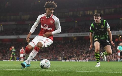"Arsene Wenger may have shifted his League Cup selection policy from fielding a youth team to giving fringe players minutes, but the competition is still the best place to see Arsenal youngsters in competitive action.  On Wednesday night, the focus was on three academy graduates who were given the chance to impress in the Carabao Cup third-round win over Doncaster Rovers. Telegraph Sport runs the rule over the trio, and assesses their chances of making a breakthrough into the first team.  Reiss Nelson Most of the pre-match excitement about Arsene Wenger's team selection on Wednesday night was the chance to see the highly-rated 17-year-old Reiss Nelson, whose squad number is more than three times his age. Nelson has been with the club since the age of nine and impressed in pre-season with his swashbuckling displays in the Emirates Cup and on the tour of Australia. He also came on for the final minutes of last week's 3-1 Europa League win against Cologne, but this was a full debut.  As he did against Benfica in the Emirates Cup, Nelson started in the right wing-back position, though it quickly became apparent that he had only a passing interest in defending, often bombing beyond Theo Walcott or meandering inside. Nelson's suspect positioning was perhaps unsurprising given that he plays mainly as an attacking midfielder for the under-23s, for whom he has scored six goals in five appearances this season.  His confidence and ability going forward was evident all night, with his bursts up the right flank causing havoc in the Doncaster defence and a couple of efforts drawing smart saves from the visitors' goalkeeper Ian Lawlor. Defensively though, Nelson was shaky and he was twice badly caught out in the second half to gift Doncaster openings that more clinical forwards would have profited from.  Reiss Nelson gets involved for Arsenal against Doncaster on Wednesday night  There was a moment in the first half that summarised the youngster's night, when he made a mess of a clearance before moments later using his searing pace to dribble away with the ball and then play a perfectly-weighted pass up the line for Theo Walcott.  The important things to remember with Nelson are his age and inexperience. He is only 17, and prior to the summer had never played in defence. Fortunately for him, Wenger has quite the pedigree in converting naturally attacking players into excellent full-backs, including Hector Bellerin, Ashley Cole and Lauren.  With his speed, athleticism and eagerness to get involved in his side's attacks, Nelson is in many ways the prototype Wengerian full-back. Expect to see more of him before the season is out, especially with Arsenal's other back-up right wing-back options either on loan (Carl Jenkinson) or out of favour (Mathieu Debuchy).  Arsenal youngsters to watch this season Ainsley Maitland-Niles At 20 years old and having made seven appearances last season, Ainsley Maitland-Niles is a relative veteran compared to Nelson. Maitland-Niles, a local lad who joined Arsenal at the age of six, is known for his versatility but said in the pre-match programme that he views himself as a central midfielder.  Having played as a defender for Arsenal previously, Maitland-Niles started as a left wing-back against Doncaster, which he also did against Cologne last week.  Like Nelson, it was clear early on that Maitland-Niles had more interest in attacking than defending. He got forward very effectively in the first half, and put in a number of dangerous crosses as he combined well with Alexis Sanchez down the Arsenal left.  In the second half, Maitland-Niles was more disciplined, as he recognised the need to hold his position and support the callow Josh Dasilva, who had come on at half-time in central defence. Maitland-Niles also showed superb speed and awareness to charge back and deny Alfie May after Nelson had been horribly caught out. Wenger says that Maitland-Niles is ""close"" to playing more regularly, while the player himself said on Wednesday that he is targeting a few Premier League stars this season. He certainly looks ready to step up, and could offer a solution to the defensive midfield area where Arsenal look so vulnerable.  Ainsley Maitland-Niles is forced to defend on Wednesday night Josh Dasilva When Calum Chambers was forced off with a hip injury at half-time, Nacho Monreal seemed the obvious choice to come on as the left-sided centre-back in the Arsenal back three. Instead Wenger turned to Josh Dasilva, an 18-year-old attacking midfielder, who only broke into the Arsenal under-21 side towards the end of last season.  Besides being physically imposing and left-footed, Dasilva - another English academy graduate - looked about as equipped for the role as the FA investigating misconduct.  His first two contributions were to pass the ball straight to an opposition player, and then get nutmegged in front of his manager. Shortly after, he got himself in a tangle and was turned by Matty Blair, before Per Mertesacker exhorted him to focus and move up alongside the rest of the back three. At times it felt as though Dasilva had been brought on to give Mertesacker some practice for his role as academy manager, which he will start next season.  Josh Dasilva plays the ball out from defence against Doncaster But as the second half wore on, Dasilva settled down and began to show his technical proficiency and comfort on the ball. He is clearly very talented, and will have learned a huge amount from playing out of position, and at a level higher than what he is used to.  It would be a surprise if Dasilva's future was at the back, but then Wenger did a similar conversion job on Kolo Toure, who arrived as a winger and became an 'Invincible' central defender."