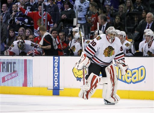 Chicago Blackhawks goalie Ray Emery (30) replaces goalie Corey Crawford, far left on the bench, during the second period after the Los Angeles Kings scored four goals against Crawford in an NHL hockey game in Los Angeles, Saturday, Feb. 25, 2012. (AP Photo/Alex Gallardo)