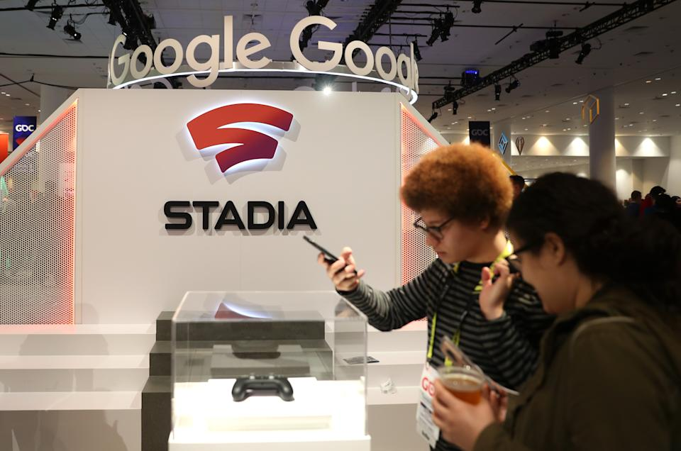 SAN FRANCISCO, CALIFORNIA - MARCH 20: Attendees look at the new Stadia controller on display at the Google booth at the 2019 GDC Game Developers Conference on March 20, 2019 in San Francisco, California. The GDC runs through March 22. (Photo by Justin Sullivan/Getty Images)
