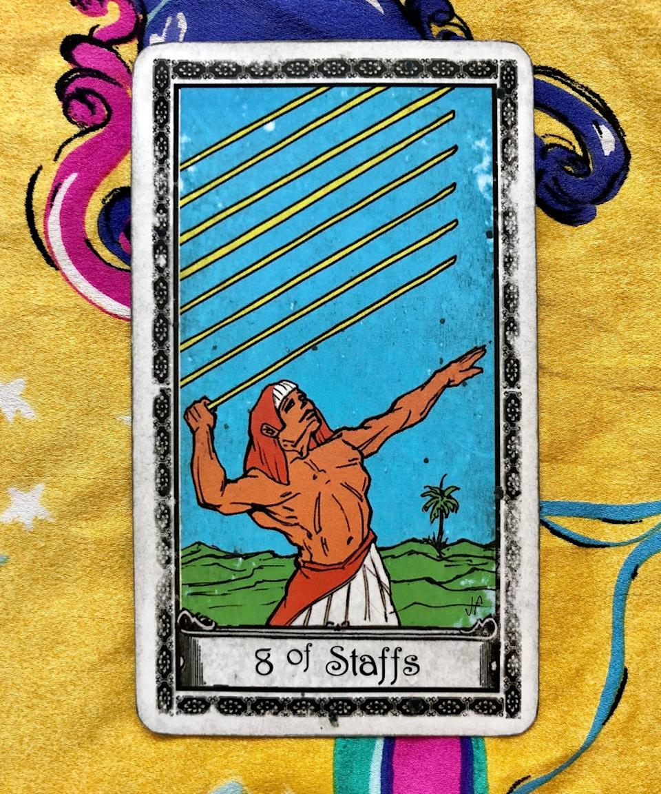 """<strong>Eight of Staffs</strong><br><br>Next, Potter pulled the Eight of Staffs. This is more of an action card, Potter said, and it signifies forward momentum — think of it like a """"just do it"""" mentality.<br><br>""""It's funny, too, because the energy of this card is pulling the arrow back and letting it go,"""" she said. """"It's kind of like Cupid is blessing you."""" This <a href=""""https://www.refinery29.com/en-us/tarot-pull-how-to-benefits"""" rel=""""nofollow noopener"""" target=""""_blank"""" data-ylk=""""slk:second pull"""" class=""""link rapid-noclick-resp"""">second pull</a> goes hand-in-hand with the Two of Swords: You've made your decision, now speak up. Say what you feel and put your love out there. """"Again this could be for anyone,"""" Potter noted. """"It could be expressing your love for your best friend; it doesn't have to be romantic.""""<span class=""""copyright"""">Photo: courtesy of Sarah Potter.</span>"""