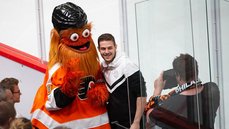 LAUSANNE, SWITZERLAND - SEPTEMBER 30: Mascot Gritty takes a photo with fans during the NHL Global Series Challenge Switzerland 2019 match between Philadelphia Flyers and Lausanne HC at Vaudoise Arena on September 30, 2019 in Lausanne, Switzerland. (Photo by Robert Hradil/NHLI via Getty Images)
