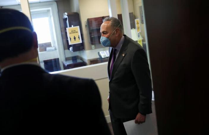 U.S. Senate Minority Leader Chuck Schumer arrives for COVID-19 news conference wearing mask on Capitol Hill in Washington