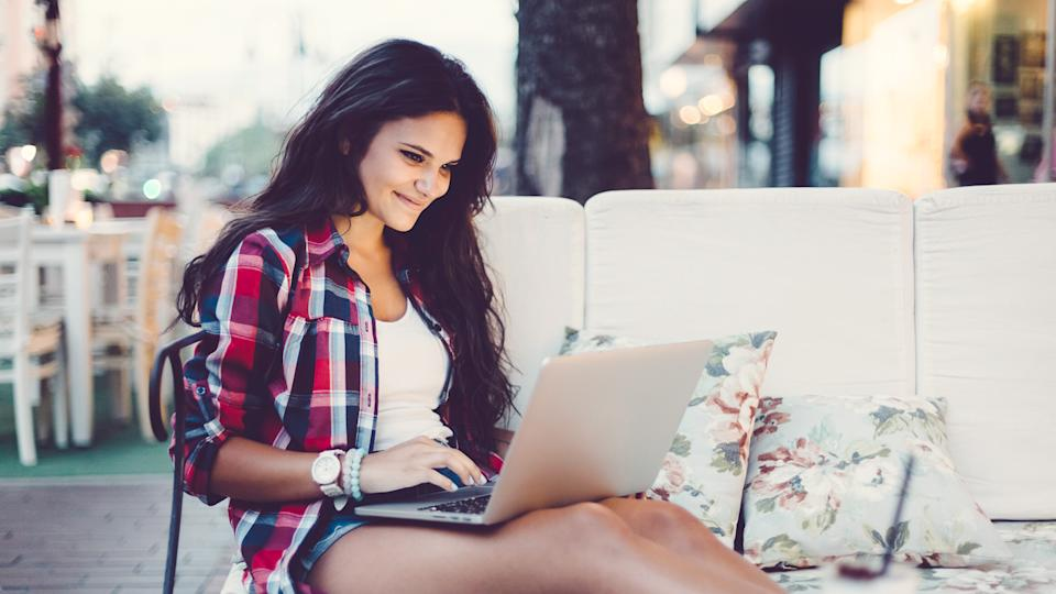 woman sitting outside while on laptop