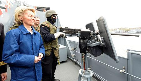 "German Defense Minister Ursula von der Leyen stands beside a soldier of German special naval forces during her visit at the German army ""Bundeswehr"" in Kiel, Germany April 21, 2017.  REUTERS/Fabian Bimmer"