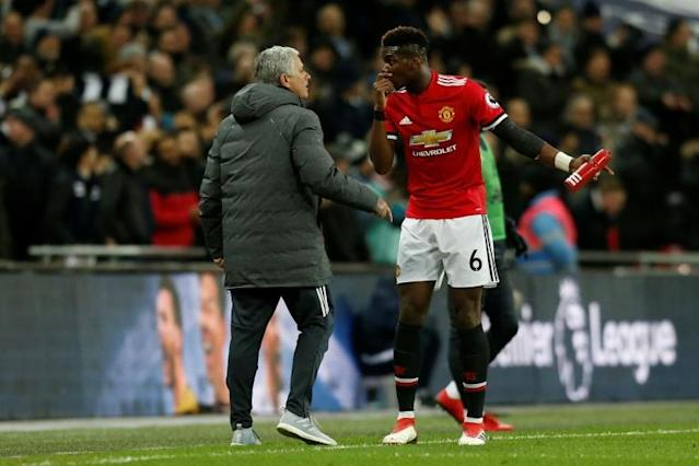 Manchester United's manager Jose Mourinho (L) talks with midfielder Paul Pogba on the sidelines in January 2018