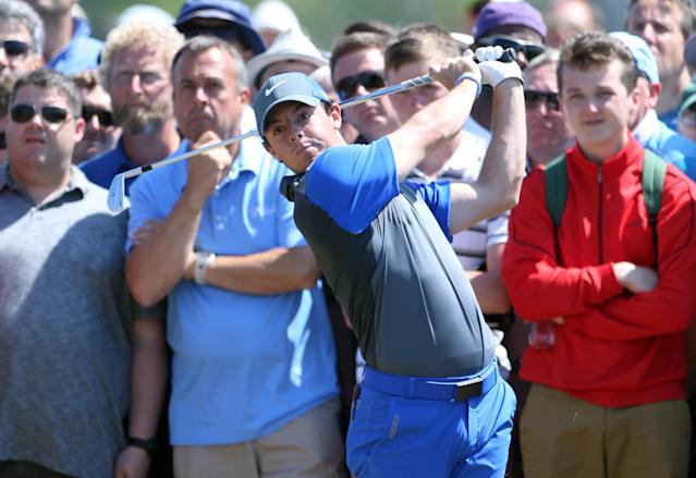 Rory McIlroy of Northern Ireland plays a shot on the 16th hole during the first day of the British Open Golf championship at the Royal Liverpool golf club, Hoylake, England, Thursday July 17, 2014. (AP Photo/Peter Morrison)