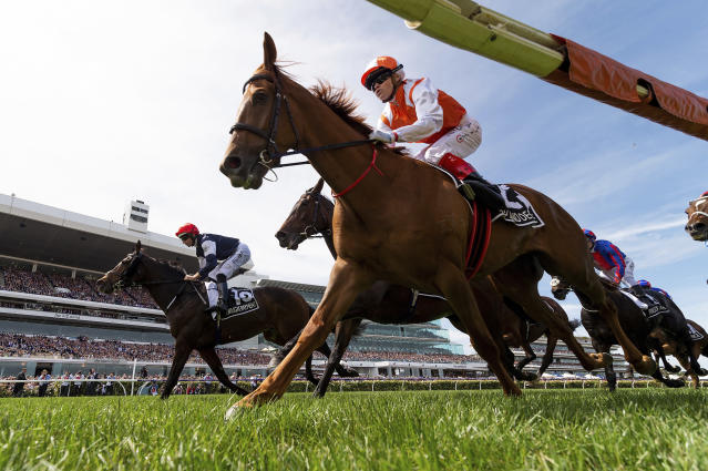 Jockey Craig Williams, front, rides Vow and Declare to victory in the Melbourne Cup horse race in Melbourne, Australia, Tuesday, Nov. 5, 2019. (Albert Perez/AAP Image via AP)