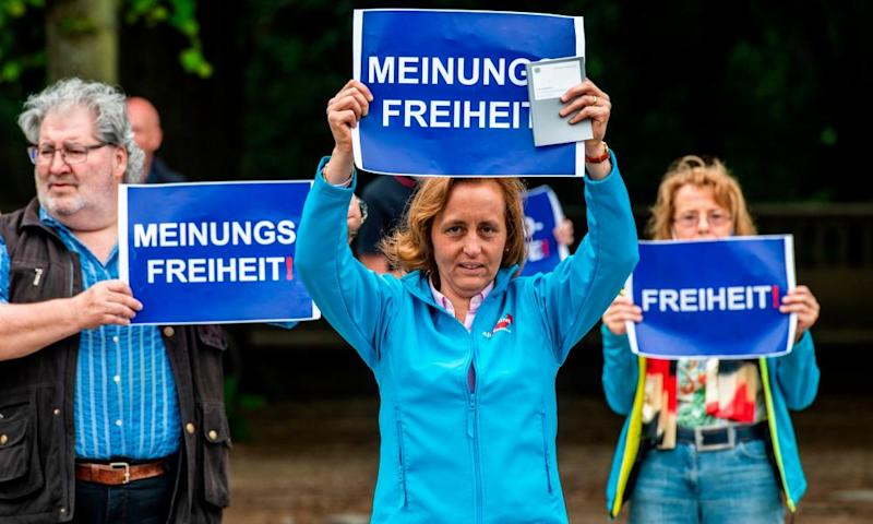 Deputy leader of the far-right Alternative for Germany party Beatrix von Storch holds up a placard reading: 'Freedom of Speech' during an anti-lockdown protest in Berlin.