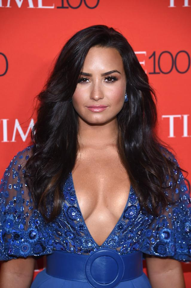 <p>Demi Lovato glowed at the 2017 Time 100 Gala with voluminous locks, lush lashes, and bronzed makeup. (Photo: Dimitrios Kambouris/Getty Images for Time) </p>