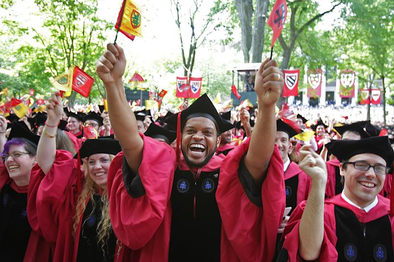 Harvard students at a 2016 commencement ceremony. (Suzanne Kreiter/The Boston Globe via Getty Images)