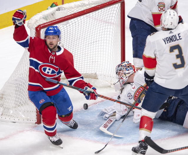 Montreal Canadiens left wing Tomas Tatar (90) reacts after scoring his second goal of the game against Florida Panthers goaltender James Reimer (34) during the first period of an NHL hockey game Tuesday, March 26, 2019, in Montreal. (Ryan Remiorz/The Canadian Press via AP)