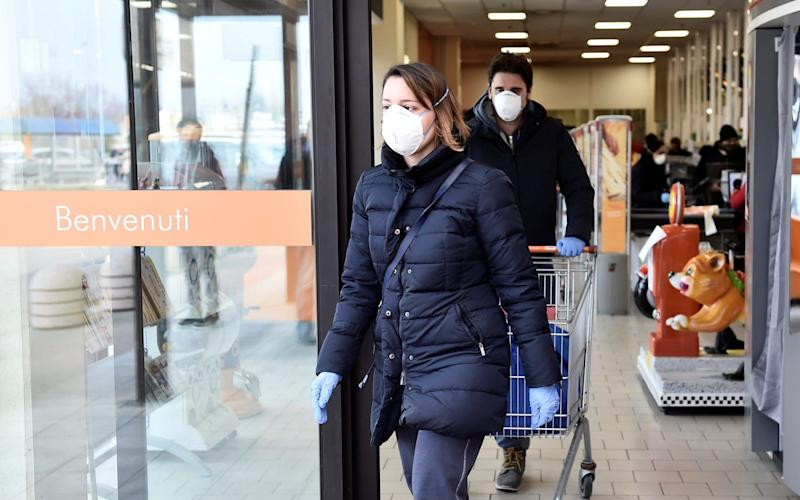 People wearing face masks leave a supermarket in the town of Casalpusterlengo, which has been closed by the Italian government due to a coronavirus outbreak in northern Italy, - reuters