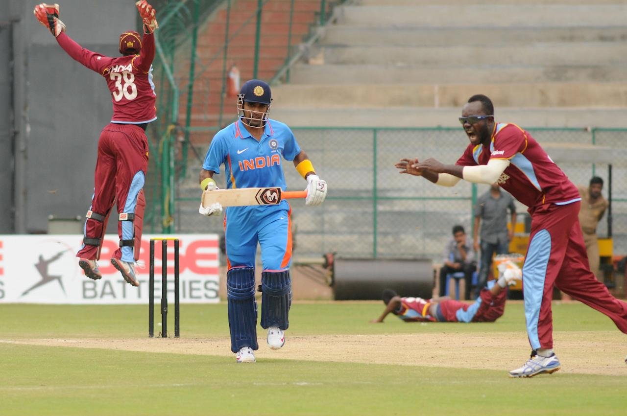 West Indies A team players celebrates after the wicket of India A team, during  India A team v/s West Indies A team unofficial T-20 cricket match at Chinnaswamy Stadium, in Bangalore on Saturday 21st of Sept. 2013. (Photo: IANS)