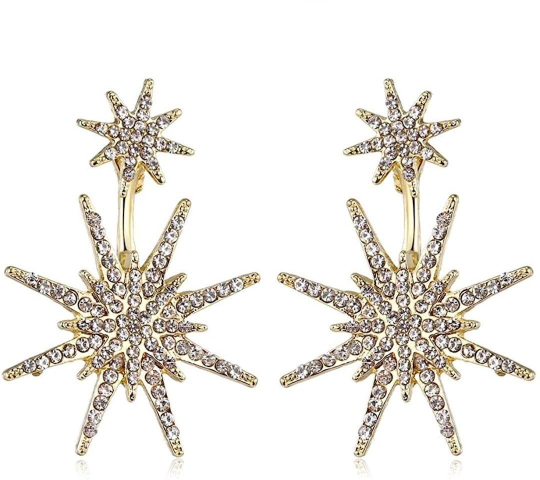 "<p>These <a href=""https://www.popsugar.com/buy/Gold-Star-Statement-Dangle-Earrings-512902?p_name=Gold%20Star%20Statement%20Dangle%20Earrings&retailer=amazon.com&pid=512902&price=9&evar1=fab%3Aus&evar9=46859993&evar98=https%3A%2F%2Fwww.popsugar.com%2Fphoto-gallery%2F46859993%2Fimage%2F46860982%2FGold-Star-Statement-Dangle-Earrings&list1=shopping%2Camazon%2Choliday%2Cwinter%20fashion%2Choliday%20fashion%2C50%20under%20%2450%2Cgifts%20for%20women%2Caffordable%20shopping&prop13=api&pdata=1"" rel=""nofollow"" data-shoppable-link=""1"" target=""_blank"" class=""ga-track"" data-ga-category=""Related"" data-ga-label=""https://www.amazon.com/Dangling-Earrings-Fashion-Wedding-Christmas/dp/B01N9AZEAR/ref=sr_1_4?crid=3SOUDD2G9GXIQ&amp;dchild=1&amp;keywords=statement+earrings+for+women&amp;qid=1573069853&amp;sprefix=statement+earri%2Caps%2C230&amp;sr=8-4"" data-ga-action=""In-Line Links"">Gold Star Statement Dangle Earrings </a> ($9) are the prettiest touch for any outfit.</p>"