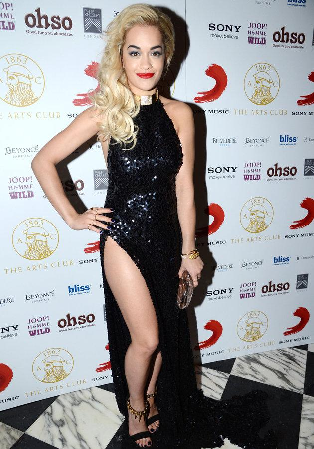 Rita Ora wore the most daring dress with a thigh high split we've seen in a LONG time to the BRITs 2013. Copyright [PA]