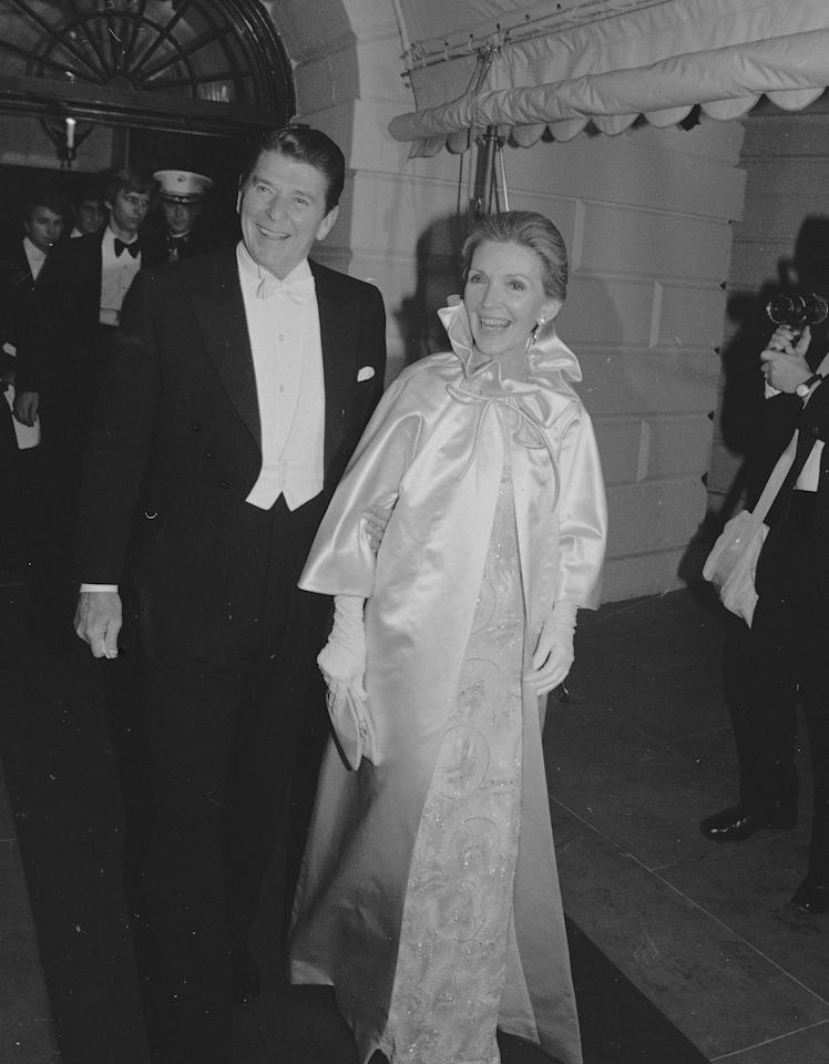 Pres. Ronald Reagan and first lady Nancy Reagan leave the White House to attend the first of several inaugural balls in Washington, Jan. 20, 1981.  (AP Photo)