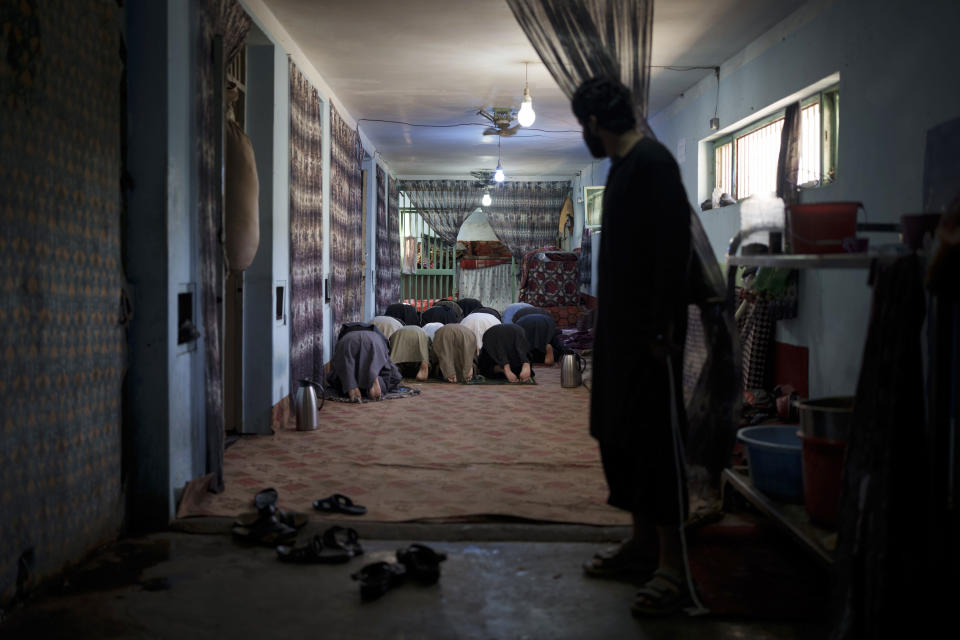 Recently arrested prisoners pray inside the Pul-e-Charkhi prison in Kabul, Afghanistan, Monday, Sept. 13, 2021. Pul-e-Charkhi was previously the main government prison for holding captured Taliban and was long notorious for abuses, poor conditions and severe overcrowding with thousands of prisoners. Now after their takeover of the country, the Taliban control it and are getting it back up and running, current holding around 60 people, mainly drug addicts and accused criminals. (AP Photo/Felipe Dana)