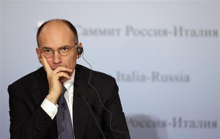 Italy's Prime Minister Enrico Letta looks on during a news conference with Russia's President Vladimir Putin in Trieste