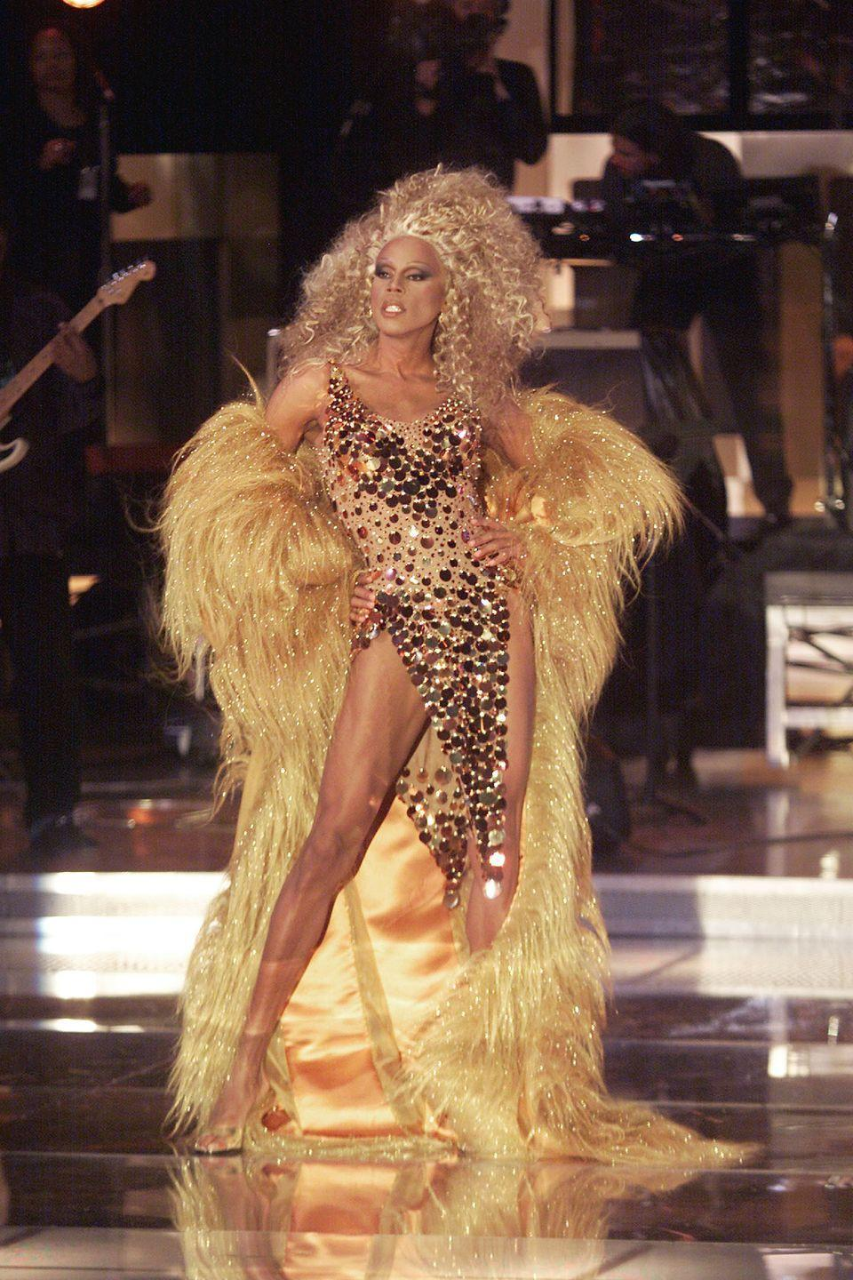<p>If you are going to pay tribute to Diana Ross, you better show up looking over-the-top amazing, and RuPaul hit that challenge out of the park. This <em>VH1 Divas 2000</em> ensemble had gold, glitter, features and a massive lioness wig. </p>