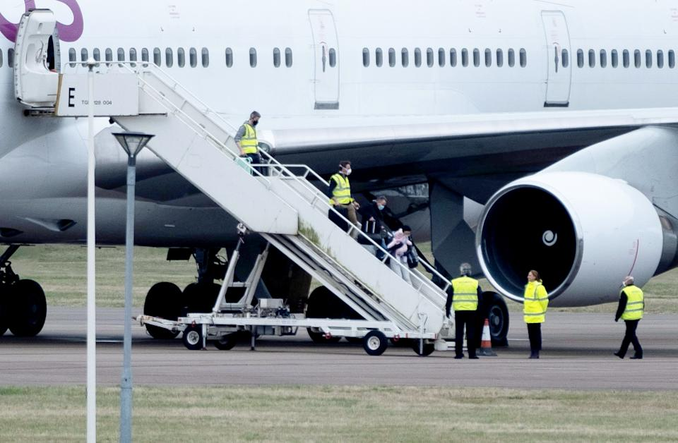 British people arrive back in the UK after being evacuated from Wuhan. (SWNS)