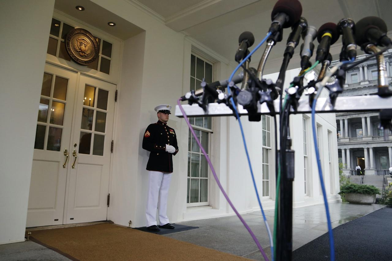 A set of microphones stands ready for comments from U.S. House Speaker John Boehner (R-OH), who declined to speak to reporters after meeting with U.S. President Barack Obama at the White House in Washington, October 10, 2013. Republicans in the House of Representatives offered a plan on Thursday that would postpone a possible U.S. default, signaling new willingness to end a standoff that has shuttered large parts of the government and thrown America's future creditworthiness into question. REUTERS/Jonathan Ernst (UNITED STATES - Tags: POLITICS BUSINESS TPX IMAGES OF THE DAY)