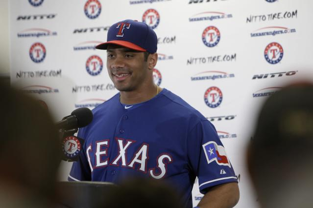 SURPRISE, AZ - MARCH 03: Russell Wilson #13 of the Texas Rangers speaks at the post game press conference after the 5-6 loss to the Cleveland Indians at Surprise Stadium on March 03, 2014 in Surprise, Arizona. (Photo by Mike McGinnis/Getty Images)