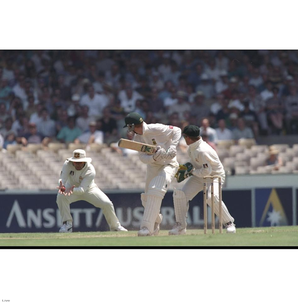 3 Jan 1998:  Mark Taylor, the captain of Australia (left) catches Shaun Pollock of South Africa during the second test match against South Africa at the Sydney Cricket Ground in Australia. Mandatory Credit:  Ben Radford /Allsport