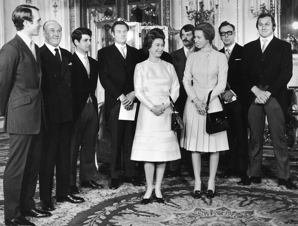 A photo of Princess Anne, Captain Mark Phillips and Queen Elizabeth with a group of guests including Inspector James Beaton, journalist Brian McConnell and Detective Constable Peter Edmonds who were all involved with foiling a kidnap attempt on the Princess, 26th November 1974.