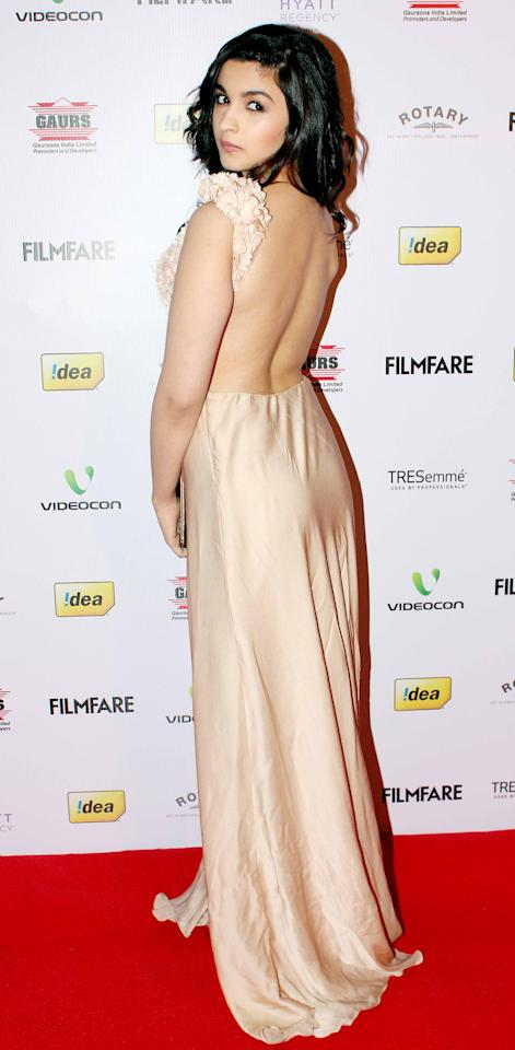 Alia shows off the back of her nude shaded dress.