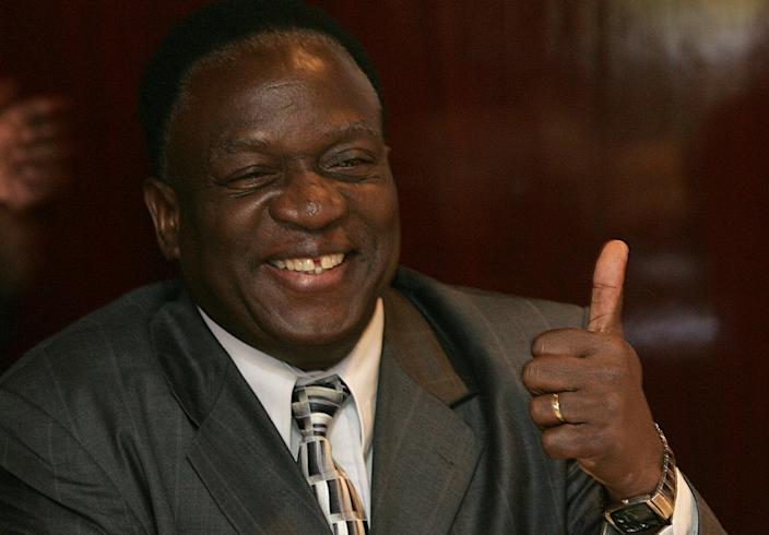 Emmerson Mnangagwa, pictured in Harare on 2008, is in pole position to be Zimbabwe's next president after his promotion to vice president (AFP Photo/Alexander Joe)