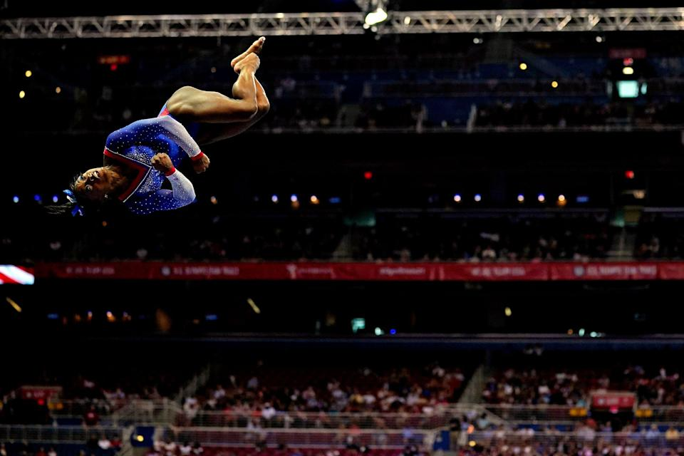 Simone Biles competes on the beam during the U.S. Gymnastics Olympic Team Trials at The Dome at America's Center on June 25, 2021, in St. Louis, Missouri