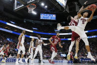 <p>Chuma Okeke #5 of the Auburn Tigers battles for a rebound with Ivan Aurrecoechea #15 of the New Mexico State Aggies during the first half in the first round of the 2019 NCAA Men's Basketball Tournament at Vivint Smart Home Arena on March 21, 2019 in Salt Lake City, Utah. (Photo by Tom Pennington/Getty Images) </p>