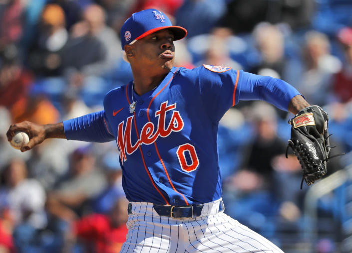 FILE - In this Feb. 28, 2020, file photo, New York Mets pitcher Marcus Stroman throws during the first inning of a spring training baseball game against the St. Louis Cardinals in Port St. Lucie, Fla. MLB pitchers are eager to fire some fastballs and spin a few breaking balls now that a semi-normal spring training has started. Coaches and executives are trying to make sure everyone stays healthy. (AP Photo/Jeff Roberson, File)