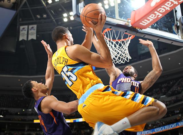 Denver Nuggets forward Anthony Randolph, center, drives for a shot as Phoenix Suns guard Gerald Green, left, and forward Markieff Morris cover in the fourth quarter of the Suns' 103-99 victory in an NBA basketball game in Denver on Friday, Dec. 20, 2013. (AP Photo/David Zalubowski)