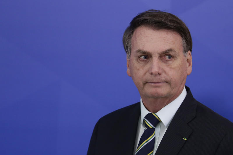 Brazil's President Jair Bolsonaro arrives to a press conference to speak on the resignation of Justice Minister Sergio Moro, at the Planalto Presidential Palace in Brasilia, Brazil, Friday, April 24, 2020. Moro, who became popular as a crusader against corruption, resigned on Friday, alleging political interference in the federal police force. (AP Photo/Eraldo Peres)