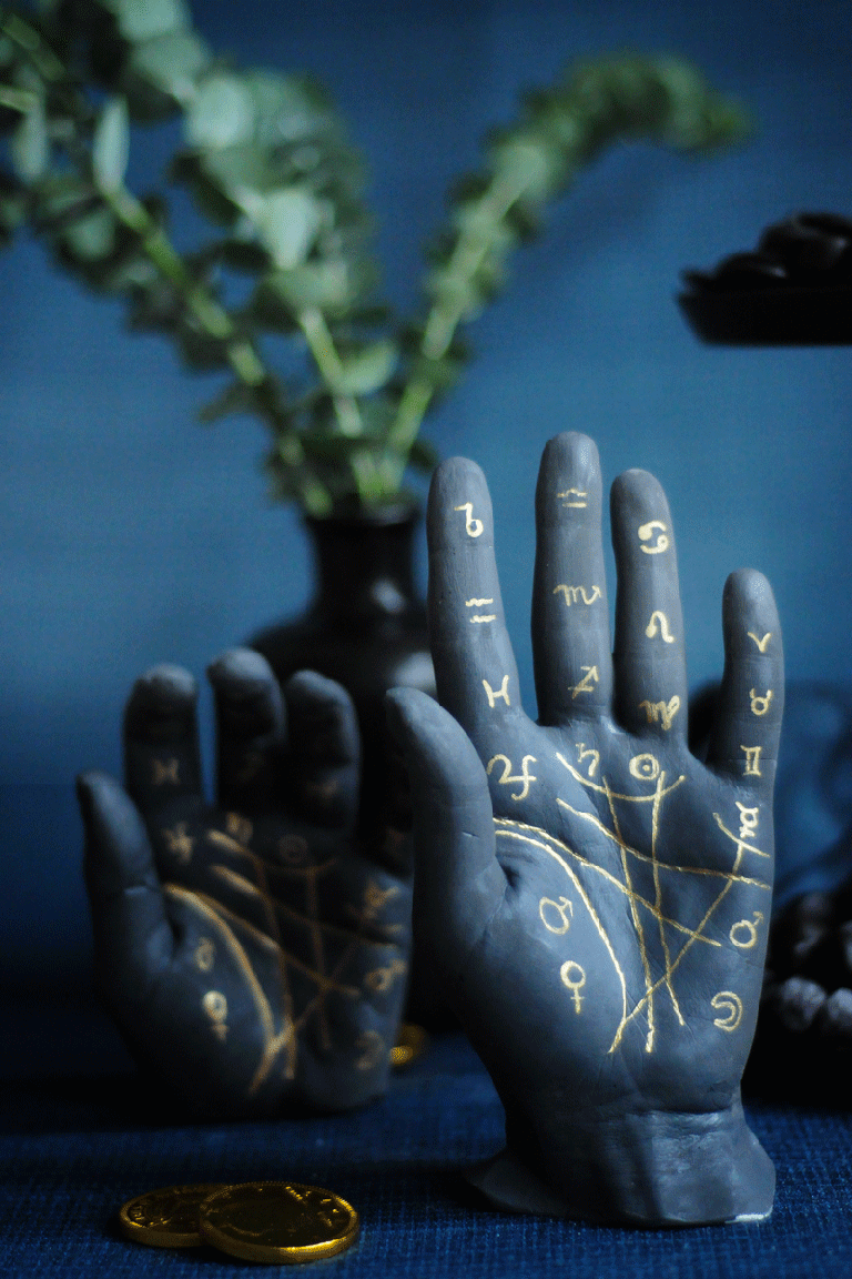 """<p>These spooky plaster palm centerpieces are guaranteed to be a hit with your kids. <br></p><p><em><a href=""""https://projectkid.com/palmistry-plaster-hands/"""" rel=""""nofollow noopener"""" target=""""_blank"""" data-ylk=""""slk:Get the tutorial at Project Kid »"""" class=""""link rapid-noclick-resp"""">Get the tutorial at Project Kid »</a></em></p><p><a class=""""link rapid-noclick-resp"""" href=""""https://www.amazon.com/Perfect-Cast-Paint-Casting-Material/dp/B0006O87CS/ref=asc_df_B0006O87CS/?tag=syn-yahoo-20&ascsubtag=%5Bartid%7C10055.g.33437890%5Bsrc%7Cyahoo-us"""" rel=""""nofollow noopener"""" target=""""_blank"""" data-ylk=""""slk:SHOP CASTING PLASTER"""">SHOP CASTING PLASTER</a></p>"""