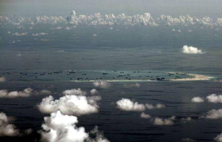 FILE PHOTO -  An aerial photo taken though a glass window of a Philippine military plane shows the alleged on-going land reclamation by China on mischief reef in the Spratly Islands