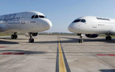 An Airbus A320neo aircraft and a Bombardier CSeries aircraft are pictured during a news conference to announce a partnership between Airbus and Bombardier on the C Series aircraft programme, in Colomiers