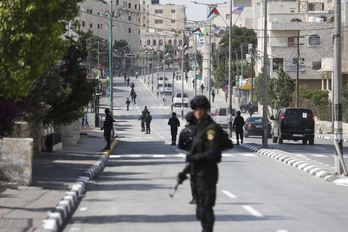 <p>Palestinian security forces line up the street during the visit of the U.S. President Donald Trump in the West Bank city of Bethlehem, Tuesday, May 23, 2017. President Trump has arrived in Bethlehem for a meeting with Palestinian President Mahmoud Abbas.(AP Photo: Nasser Shiyoukhi/AP) </p>