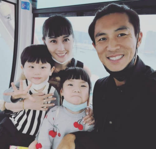 Shaun with wife Yann Ren and their two children