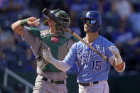 Kansas City Royals' Whit Merrifield flips his bat after striking out during the seventh inning of a baseball game against the Oakland Athletics Thursday, Sept. 16, 2021, in Kansas City, Mo. (AP Photo/Charlie Riedel)