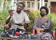 Uganda's leading opposition challenger Bobi Wine, left, and his wife Barbie Kyagulanyi, give a press conference after casting their votes in Kampala, Uganda, Thursday, Jan. 14, 2021. Long lines of Ugandans are voting in a presidential election tainted by widespread violence that some fear could escalate as security forces try to stop supporters of leading opposition challenger Bobi Wine from monitoring polling stations. (AP Photo/Nicholas Bamulanzeki)